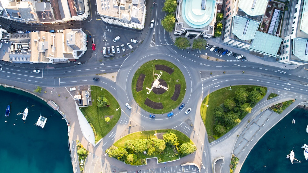 picture of a roundabout in a coastal society from above.