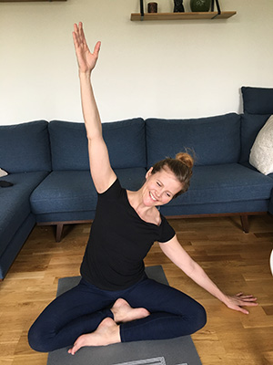 Johanna Hagerman performs yoga at home in the living room.